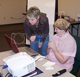 Gail and Tammy check the computer